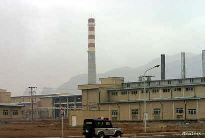 A security car passes in front of the Natanz nuclear facility located 300 kilometers (185 miles) south of Tehran, Nov. 20, 2004.