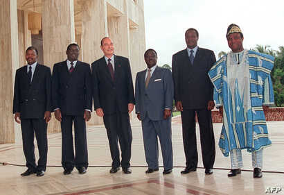 FILE - In this photo taken on July 21, 1995, French President Jacques Chirac (3rdL) and leaders of sub-Saharian African states  pose in Yamoussoukro for a family photo before their talks.