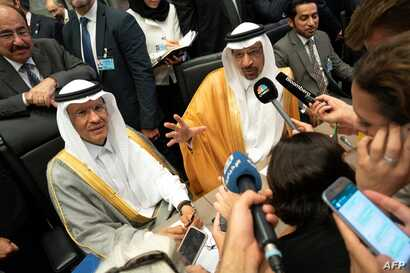 FILE - In this file photo taken July 01, 2019, Saudi Arabia's Energy Minister Khaled al-Falih (R) and Saudi Deputy Oil Minister Prince Abdulaziz bin Salman bin Abdulaziz talk to the press on the sidelines of an oil meeting in Vienna, Austria.
