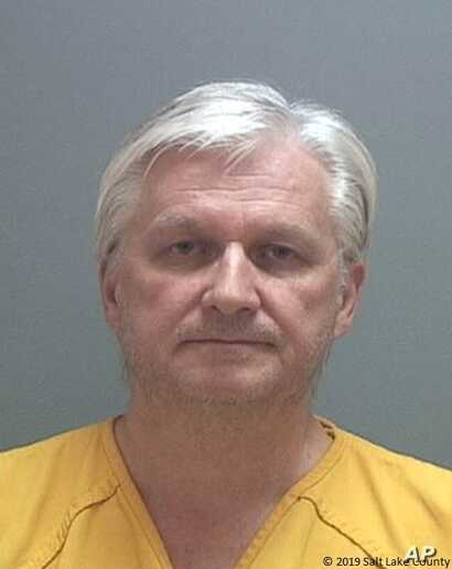 This photo released by the Salt Lake County Sheriff's Office shows Ron Rockwell Hansen, a former U.S. intelligence officer who pleaded guilty to trying to sell secrets to China.