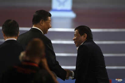 China's President Xi Jinping, left, shakes hands with Philippines President Rodrigo Duterte during the opening ceremony of the 2019 Basketball World Cup in Beijing, China, Aug. 30, 2019.