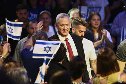 Blue and White party leader Benny Gantz gets surrounded by his supporters as he arrives to election campaign in Tel Aviv, Israel, Sept. 15, 2019.