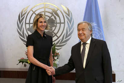 New U.S. Ambassador Kelly Craft shakes hands U.N. Secretary General Antonio Guterres after she presented her credentials at United Nations headquarters, in New York, Sept. 12, 2019.