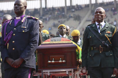 The coffin carrying the remains of former Zimbabwean leader Robert Mugabe arrives at the National Sports stadium during a funeral procession in Harare, Sept, 14, 2019.