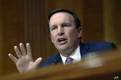 Democratic Senator Chris Murphy questions questions a witness during a hearing on Capitol Hill in Washington, July 25, 2018.