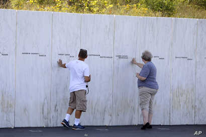 Visitors to the Flight 93 National Memorial in Shanksville, Pa., view the Wall of Names, Sept. 10, 2019, as the nation prepares to mark the 18th anniversary of the Sept. 11, 2001 attacks.