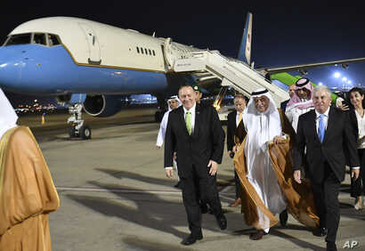 FILE - Secretary of State Mike Pompeo walks after stepping off his plane upon arrival at King Abdulaziz International Airport in Jeddah, Saudi Arabia, Sept. 18, 2019.