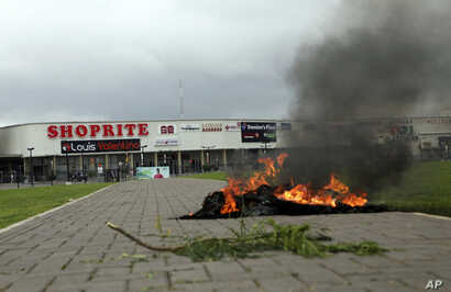 A bonfire is set outside Shoprite during a protest in Abuja, Nigeria, Sept. 4, 2019. South African-owned businesses operating in Nigeria are being targeted in retaliation for xenophobic attacks carried out against Africans working in South Africa.