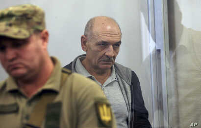 Volodymyr Tsemakh, former commander of Russian-backed separatist forces in eastern Ukraine, sits in a court room in Kyiv, Ukraine, Sept. 5, 2019. Tsemakh was one of two high-profile prisoners returned Russia.