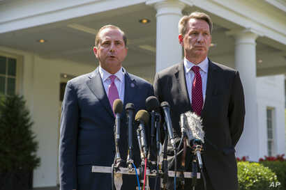 Health and Human Services Secretary Alex Azar, left, and acting FDA Commissioner Ned Sharpless speak with reporters after a meeting about vaping with President Donald Trump in the Oval Office of the White House, Sept. 11, 2019, in Washington.