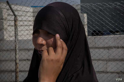 Bouchra Abouallal came to Syria in 2013 to join IS and was arrested there in 2017. She now wants to go back to Belgium, her home country, to raise her children in Europe, in Ain Issa, Syria, Sept. 1, 2019. (Yan Boechat/VOA)