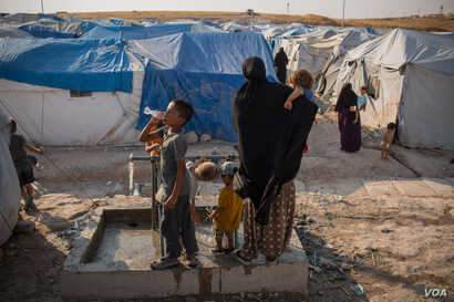 In the section set aside for foreigners in the Ain Issa Camp, 350 women and more than 1,000 children wait for news of repatriation. Most of their home countries do not want them back, Sept. 1, 2019. (Yan Boechat/VOA)