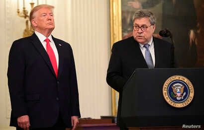 FILE - U.S. President Donald Trump and Attorney General William Barr participate in a ceremony in the East Room of the White House in Washington, Sept. 9, 2019.