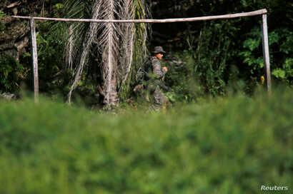 A soldier patrols during a temporary state of siege, approved by the Guatemalan Congress following the death of several soldiers last week, in the community of Semuy II, Izabal province, Guatemala, Sept. 9, 2019.