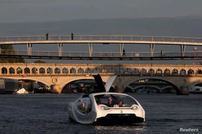 The Bubbles water taxi is seen on the River Seine during a demonstration by the SeaBubbles company in Paris, France, Sept. 16, 2019.