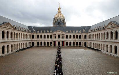 People queue to pay tribute to late French President Jacques Chirac during a popular national tribute at the Hotel des Invalides in Paris.