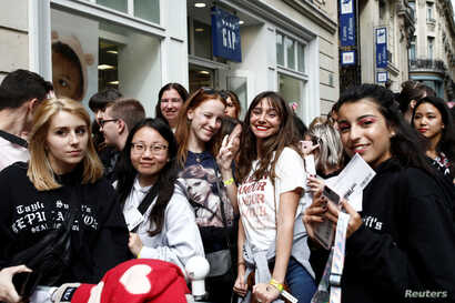 Fans of Taylor Swift wait in line to enter the Olympia Theatre prior to her concert performance in Paris, France, Sept. 9, 2019.