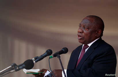 President of South Africa Cyril Ramaphosa speaks during a state funeral of Zimbabwe's longtime ruler Robert Mugabe, at the national sports stadium in Harare, Zimbabwe, Sept. 14, 2019.