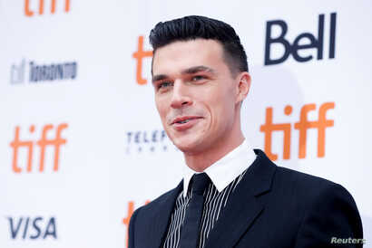 Actor Finn Wittrock poses as he arrives at the Canadian premiere of