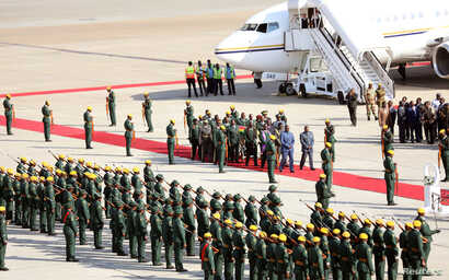 The body of former Zimbabwean President Robert Mugabe arrives back in the country after he died  in Singapore after a long illness, Harare, Sept. 11, 2019.