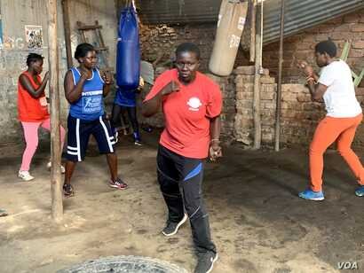 Hellen Baleke and other women warming up at Rhino boxing Club in Katanga slum, Kampala-Uganda.