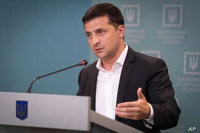 Ukrainian President Volodymyr Zelenskiy speaks to media during his press conference in Kyiv, Ukraine, Oct. 1, 2019.