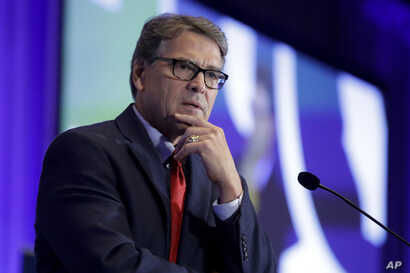 FILE - In this Sept. 6, 2019, file photo, Energy Secretary Rick Perry speaks at the California GOP fall convention in Indian…