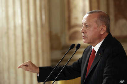 Turkey's President Recep Tayyip Erdogan addresses a conference of parliament speakers in Istanbul, Friday, Oct. 11, 2019…