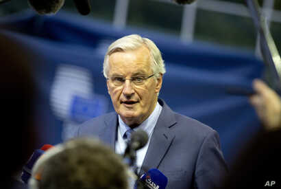 European Union chief Brexit negotiator Michel Barnier speaks with the media as he arrives for a meeting of EU General Affairs…