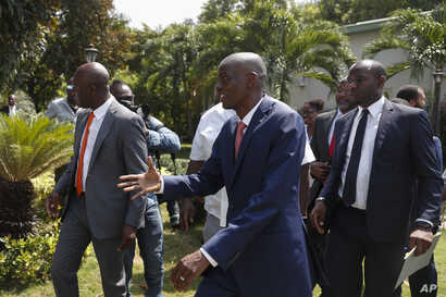 President Jovenel Moïse reaches out to greet journalists after a press conference at the National Palace in Port-au-Prince,…