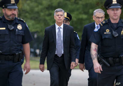 Ambassador William Taylor, is escorted by U.S. Capitol Police as he arrives to testify before House committees as part of the…