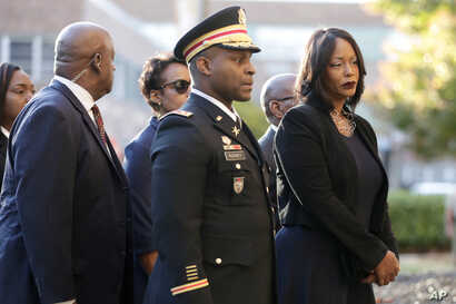 Mourners, including Maya Rockeymoore, right, widow of U.S. Rep. Elijah Cummings follow behind pallbearers walking with the…