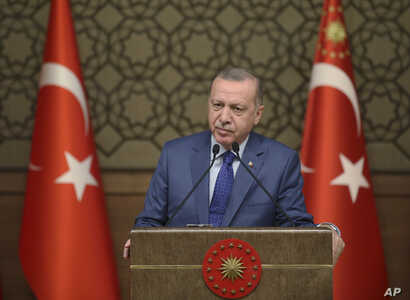 Turkish President Recep Tayyip Erdogan speaks during a meeting at his presidential palace, in Ankara, Turkey, Thursday, Oct. 24…