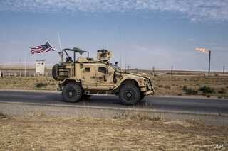 In this Oct. 28, 2019 photo, U.S. forces patrol Syrian oil fields.