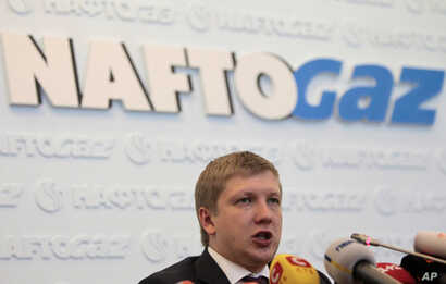 "Chairman of the board of the company ""Naftogaz"" Andrew Kobolyev speaks during a news conference in Kiev, Ukraine, Friday, June…"