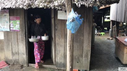 Food vendor Kong Sina emerges from her kitchen in Trach Village of Cambodia's Kampong Speu province. (Aun Chhengpor/VOA Khmer)