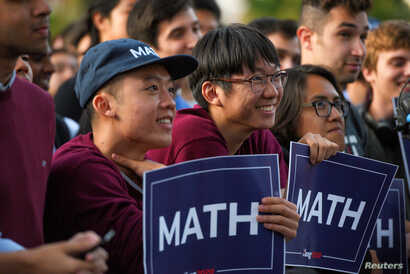 Supporters listen as Democratic U.S. presidential candidate Andrew Yang speaks during a rally in Cambridge, Massachusetts, U.S…