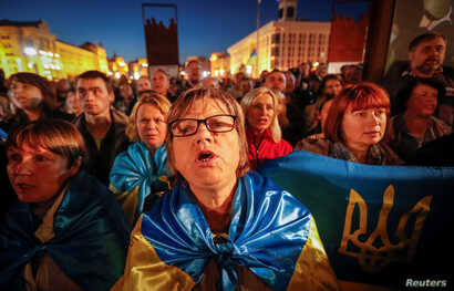 People attend a rally against recent approval of a new deal between Ukraine and Russia-backed separatists  in Kyiv, Ukraine Oct. 2, 2019.