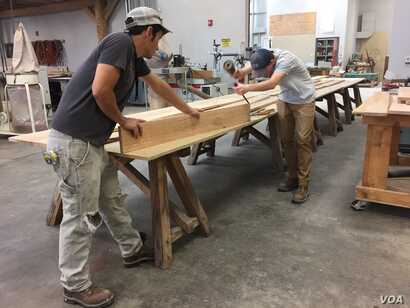 Students work on a woodworking project in a Timber Framing class at the American College of the Building Arts, Charleston, S.C.,
