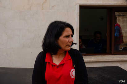 Jamila Hamee, head of the Kurdish Red Crescent in northeastern Syria, says hundreds of people have died in the past week of hostilities, in Tal Tamer, Syria, Oct. 19, 2019. (Yan Boechat/VOA)