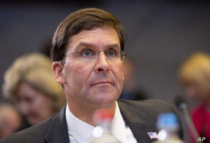 U.S. Secretary for Defense Mark Esper waits for the start of a meeting of NATO defense ministers at NATO headquarters in Brussels, Belgium, Oct. 24, 2019.
