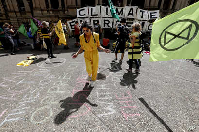 Climate protesters from the Extinction Rebellion movement demonstrate at Town Hall in Sydney, Australia, Oct. 8, 2019.