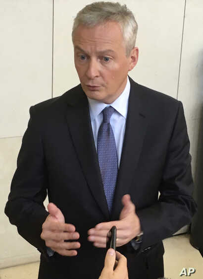 French Finance Minister Bruno Le Maire answers reporters, Oct. 31, 2019 in Paris.