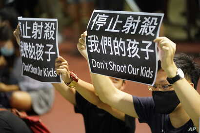 Residents of Tsuen Wan gather at an open air stadium, Oct. 2, 2019, to protest a teenage demonstrator shot at close range in the chest by a police officer in Hong Kong.