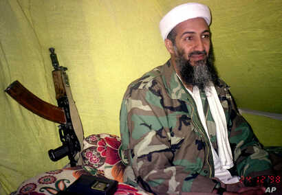 FILE - Then-al-Qaida leader Osama Bin Laden speaks to a select group of reporters in mountains of Helmand province in southern Afghanistan, Dec. 24, 1998.