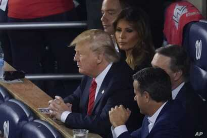 President Donald Trump watches during the second inning of Game 5 of the baseball World Series between the Houston Astros and the Washington Nationals, Oct. 27, 2019, in Washington.