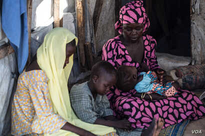 Aishatu Bulama has been reunited with her children, in Maiduguri, Nigeria. (C. Oduah/VOA)