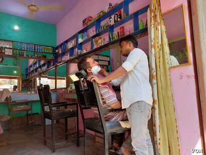 Barbers in an Indian village