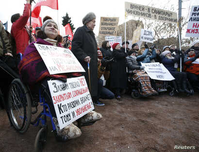 FILE - Protesters, some in wheelchairs, rally against what they see as failures in Russia's health care system, in Moscow, Nov. 2, 2014.