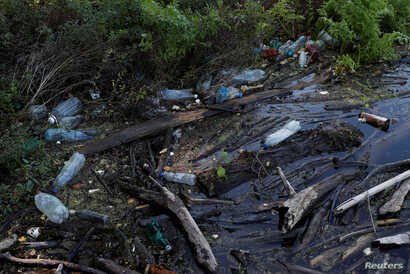 Plastic waste is seen on the River Tisza near Tiszafured, Hungary, Oct. 1, 2019.